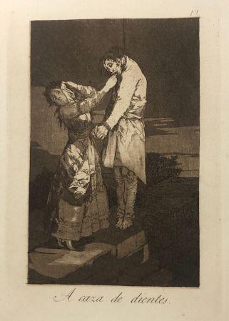Aguafuerte Goya - Capricho 12 . A caza de los dientes